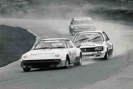 Alan Moffat leading Peter Brock and Dick Johnson in a damp ATCC race in June 1983.